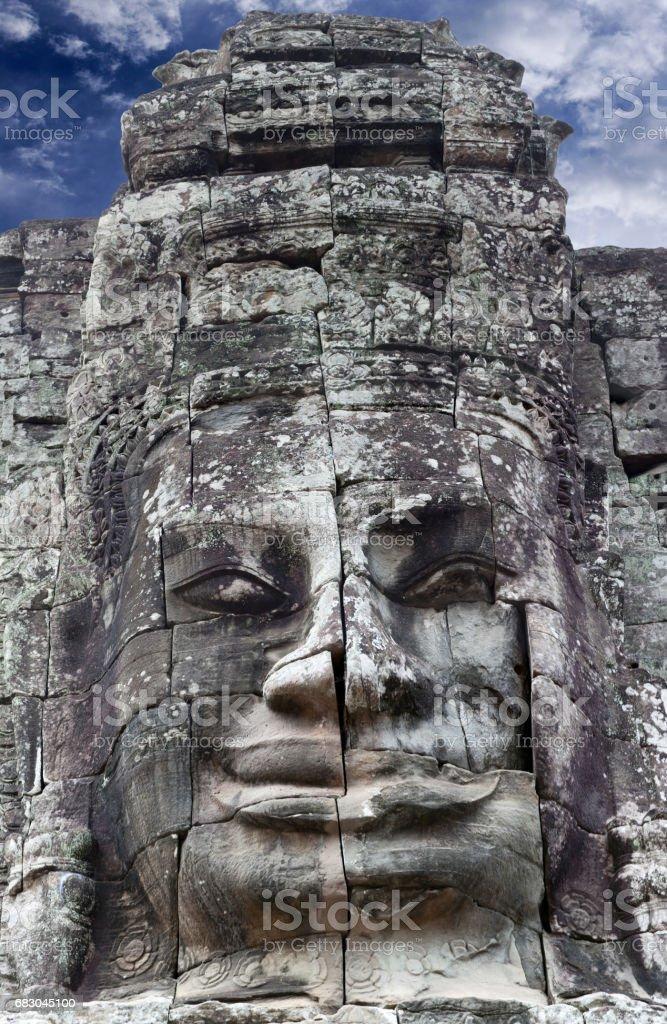 Giant stone faces at Prasat Bayon Temple, Cambodia foto de stock royalty-free
