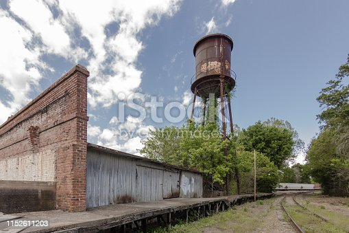 Giant water tower looms of abandoned factory in the deep south