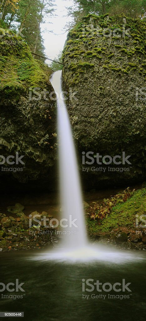 Giant Waterfall with Big Mossy Rocks royalty-free stock photo