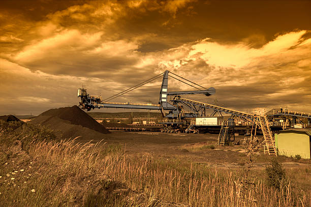 Giant wheel excavator in brown coal mine at sunset stock photo