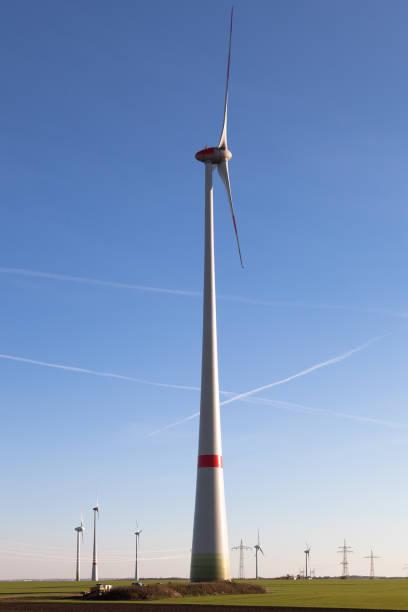 giant wind turbine under blue sky - weißenfels stock-fotos und bilder