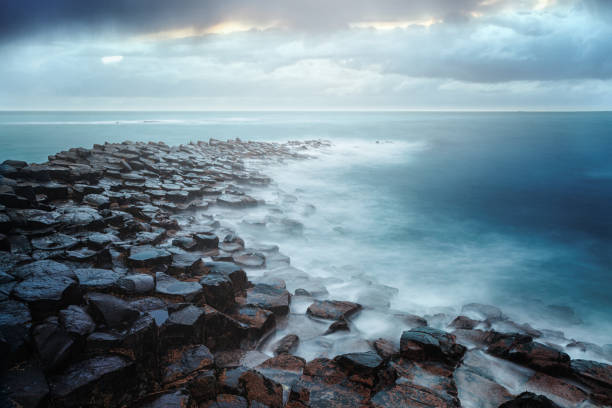 Giant's Causeway, County Antrim, Northern Ireland Giant's Causeway on a cloudy day rocky coastline stock pictures, royalty-free photos & images