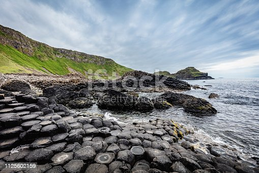Beautiful Giants Causeway Volcanic Landscape under Dramatic Skyscape. Giants Causeway, Northern Ireland, UK