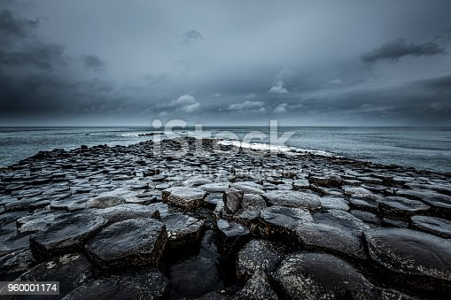 famous giants causeway stones infinity horizon over the atlantic ocean in northern ireland, europe.
