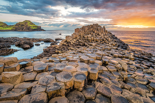 Stock photograph of a dramatic sunset at the Giant's Causeway in Northern Ireland, UK.