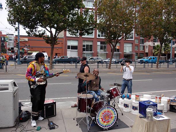 Giants fans play music outside stadium stock photo