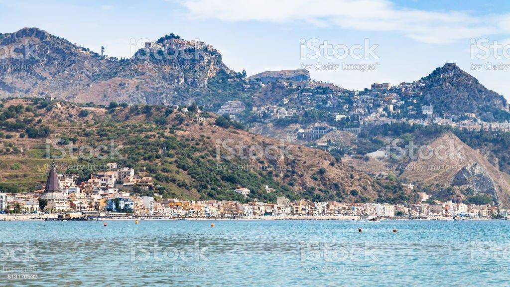 Giardini Naxos town and Taormina city on cape stock photo
