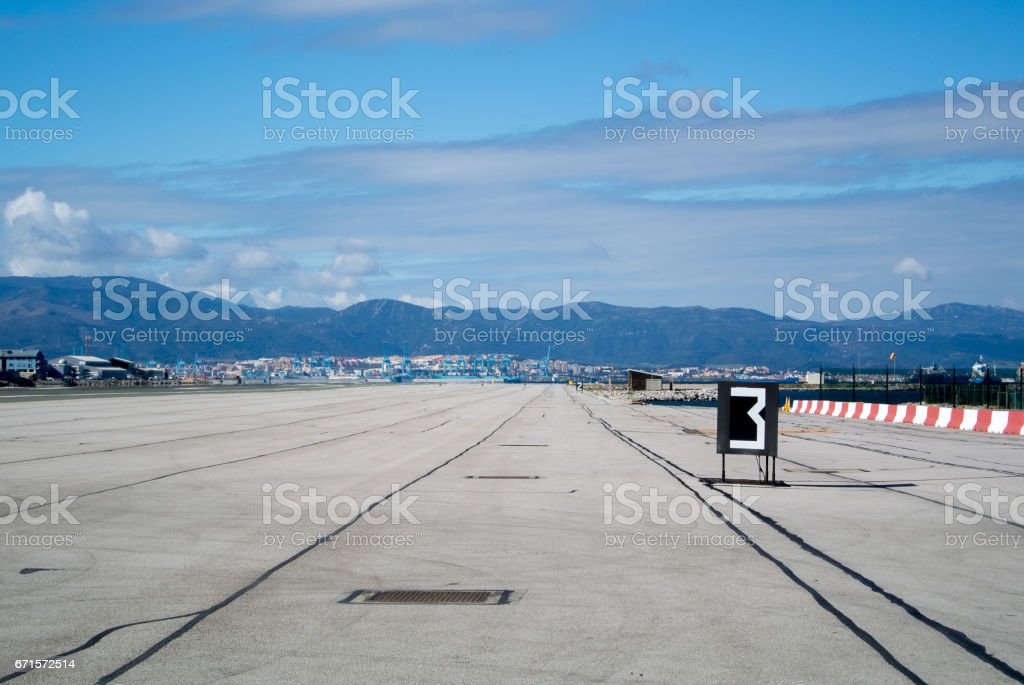 Gibraltar airport runway with mountains on background. - foto de acervo