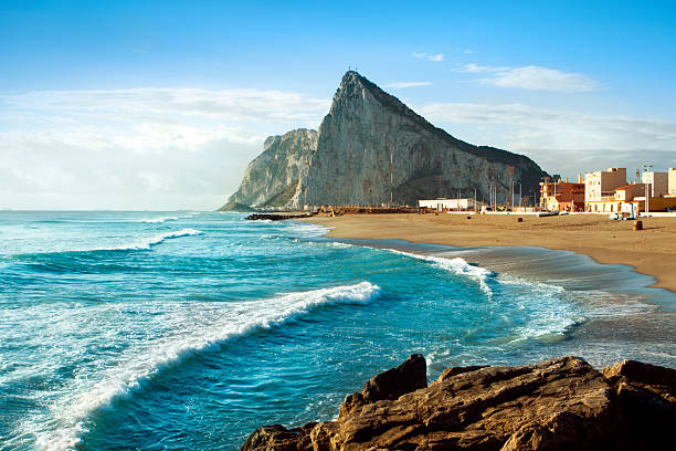 """Gibraltar and the Sea The famous """"Rock"""" of Gibraltar as seen from the Mediterranean coast of Southern Spain. rocky coastline stock pictures, royalty-free photos & images"""