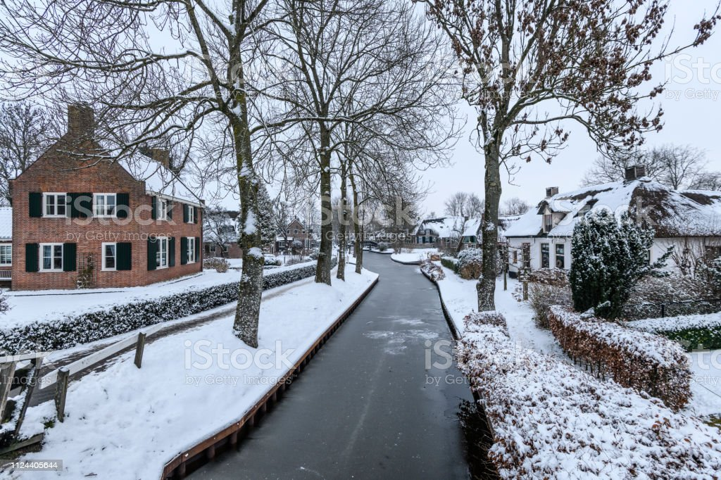 Giethoorn Village With The Canals With Snow During A Cold But