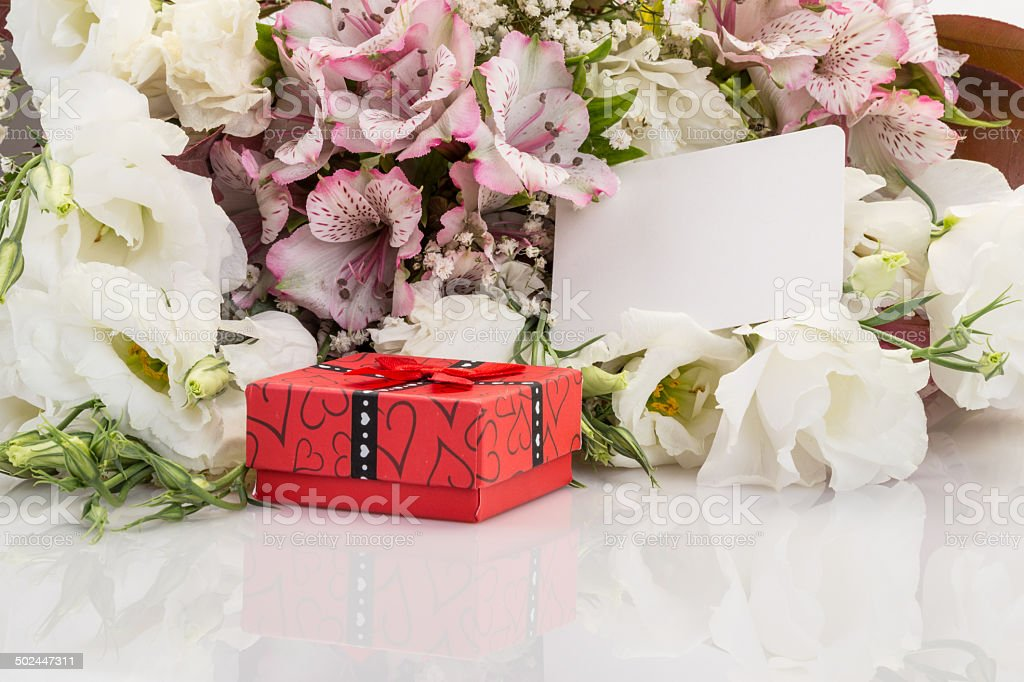 gift and flowers with reflection