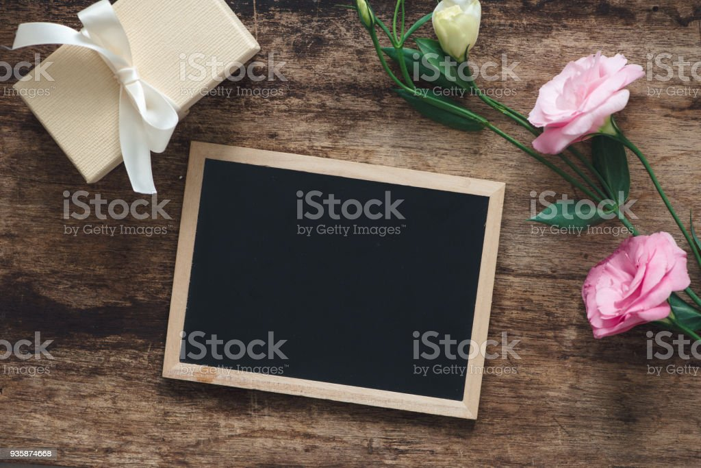 Gift and lisianthus flowers card beautiful background