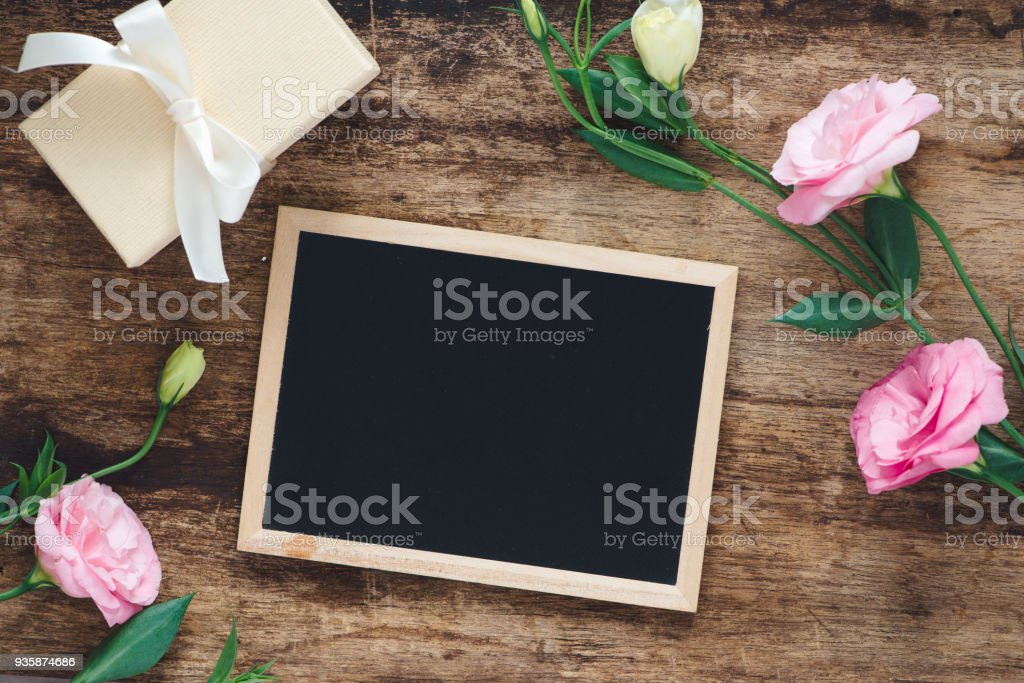 Gift and lisianthus flowers card beautiful background stock photo