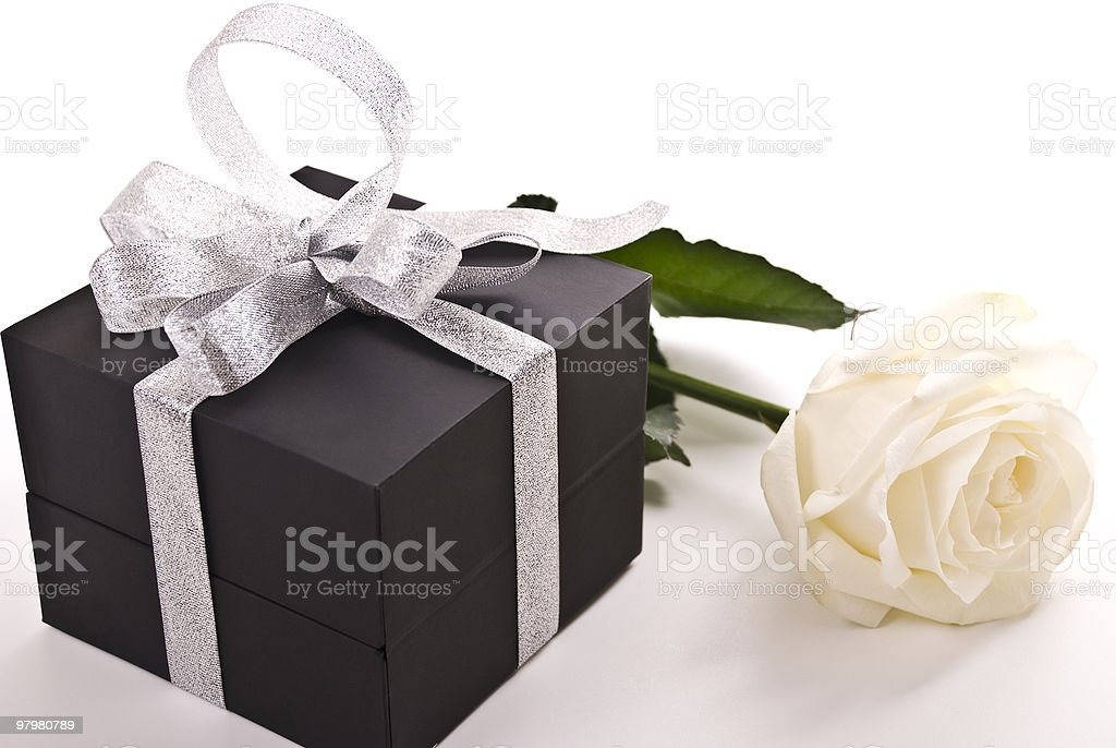 Gift and rose royalty-free stock photo