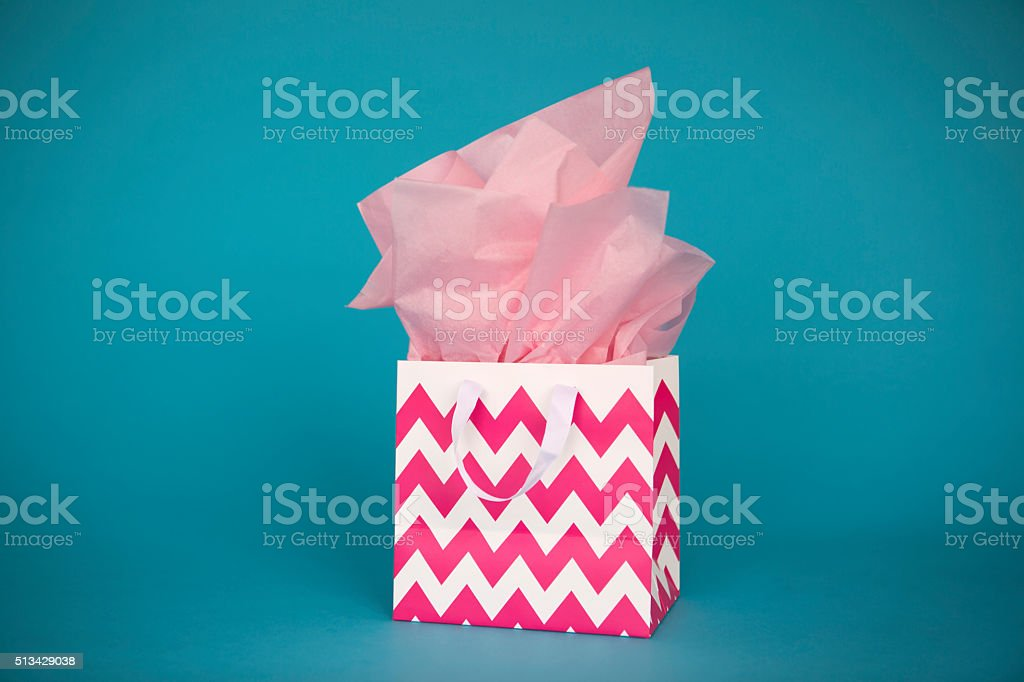 Gift bag with pink tissue paper stock photo