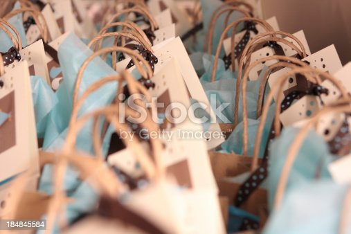 a shallow focus photo of some rows of gift bags