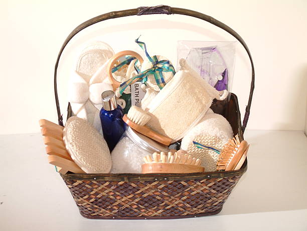 A gift basket of spa essentials Basket of bath items basket stock pictures, royalty-free photos & images