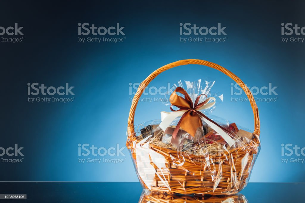 gift basket on blue background, close-up view