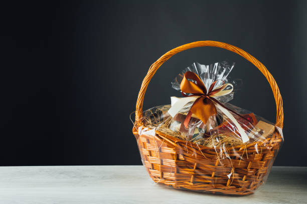 gift basket on gray background gift basket on gray background with copy-space basket stock pictures, royalty-free photos & images