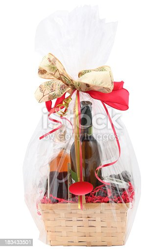 Gift basket with food on a white background.