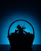 gift basket silhouette on blue background, close-up view