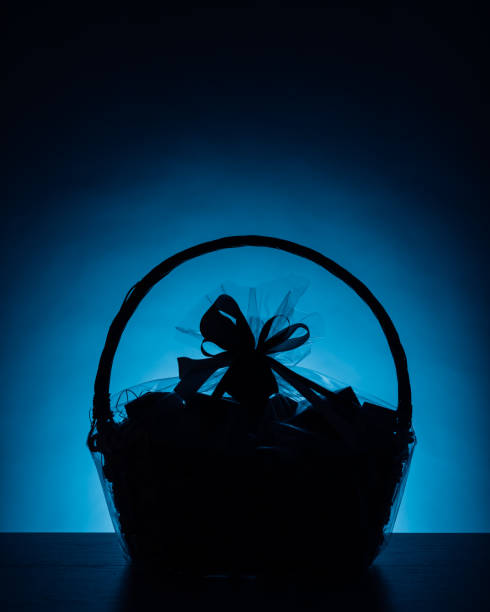 gift basket silhouette on blue background gift basket silhouette on blue background, close-up view basket stock pictures, royalty-free photos & images
