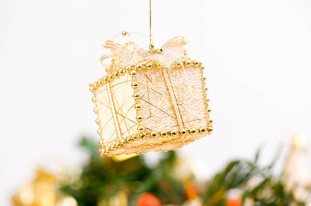 Gift Bauble in Front of Christmas Decoration stock photo