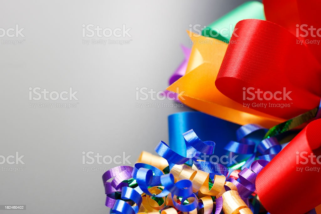Gift bows of various colors on gray background royalty-free stock photo