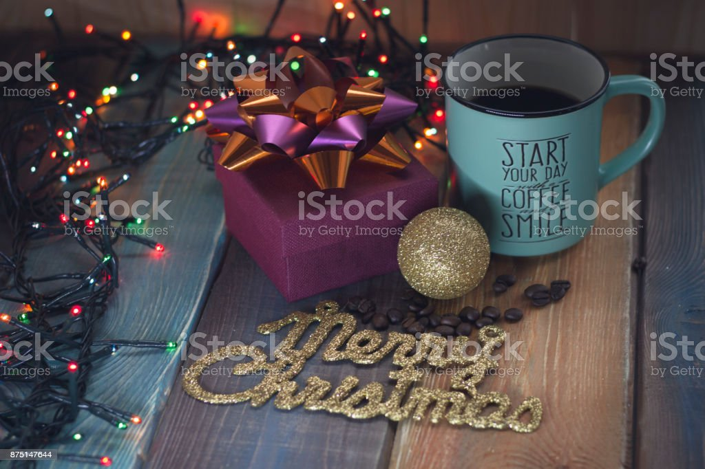 Gift box and cup of coffee, gold inscription on the table'r'n'r'n stock photo