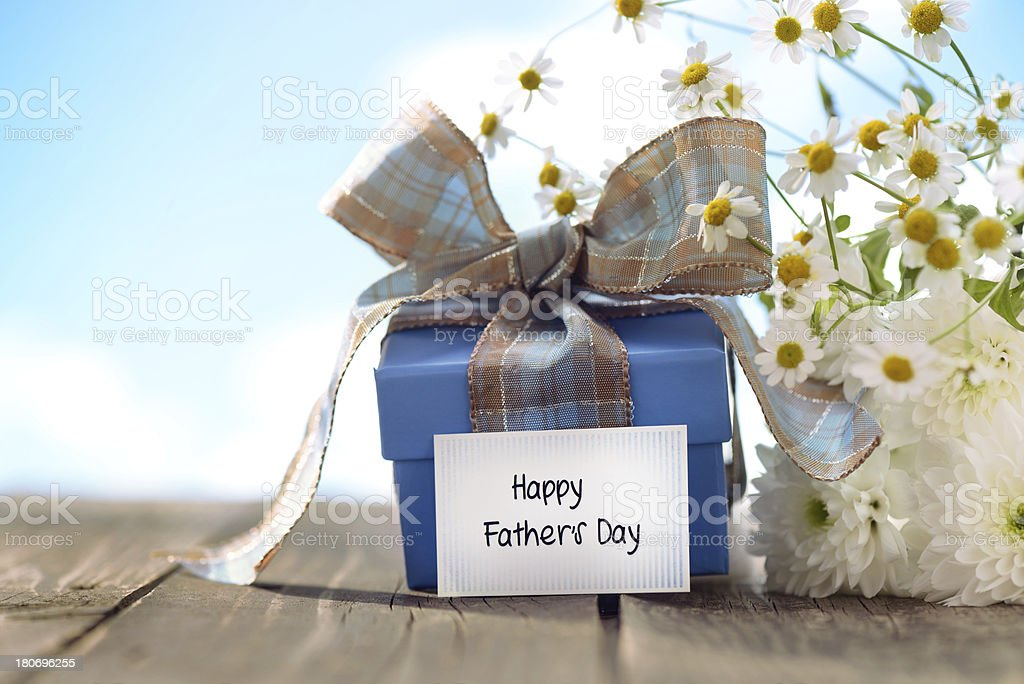 Gift box and daisy flowers with a fathers day card royalty-free stock photo