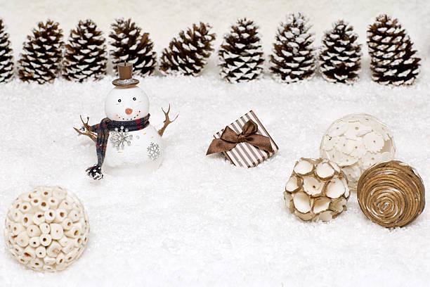 gift box and snowman are in the snow. - weihnachtsspende stock-fotos und bilder