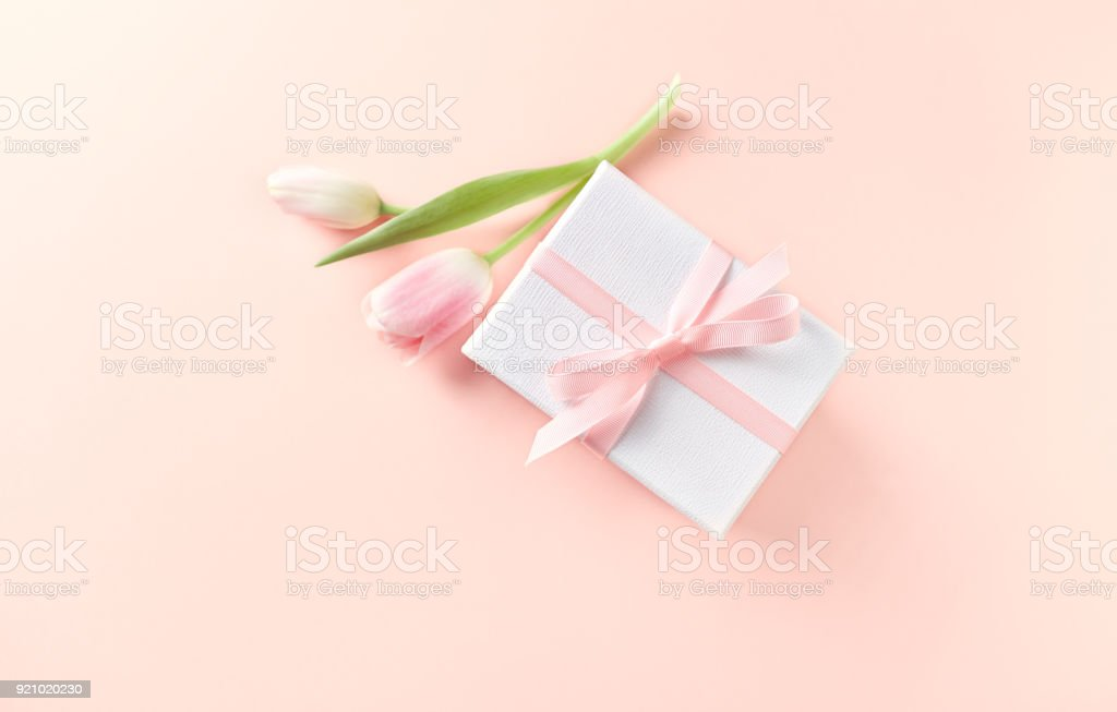 Gift Box and Spring Tulips on Powder Pink Background stock photo