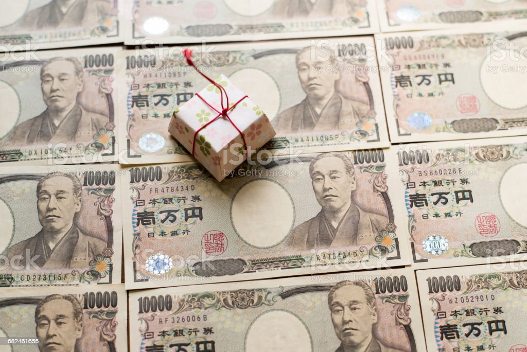 Gift box and ten thousands yen bills royalty-free stock photo