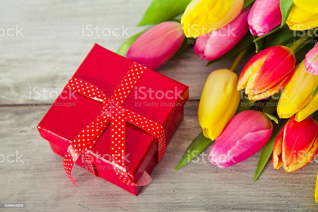 gift box and tulips stock photo