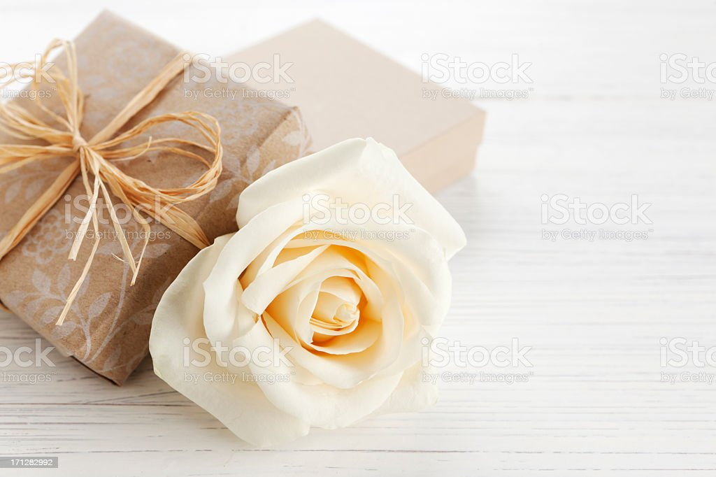 Gift box and white rose royalty-free stock photo
