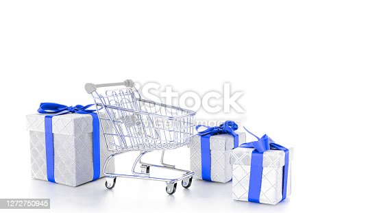 Gift box blue ribbon. Trolley cart for supermarket with christmas or birthday gift box isolated on white background. Minimalism style. Creative design for valentine, xmas surprise package