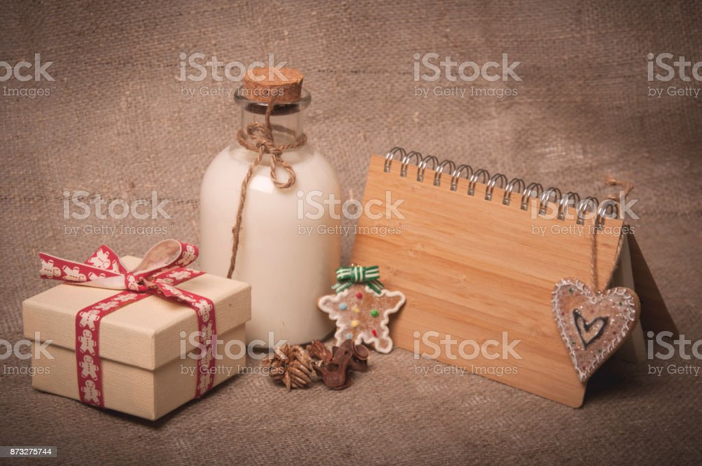 gift box, bottle of milk and notebook on background of linen stock photo