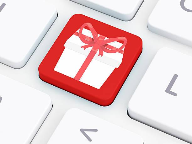 geschenkbox taste auf tastatur - weihnachtsprogramm stock-fotos und bilder