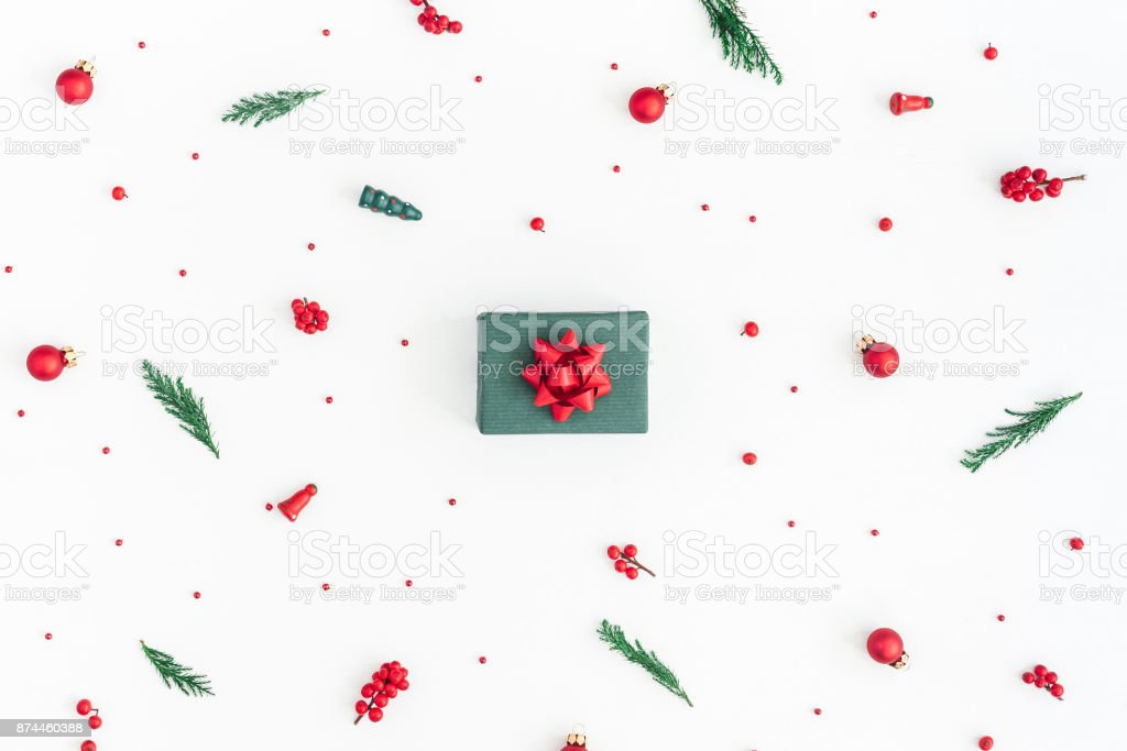 Gift box, christmas tree branches, decorations. Flat lay, top view