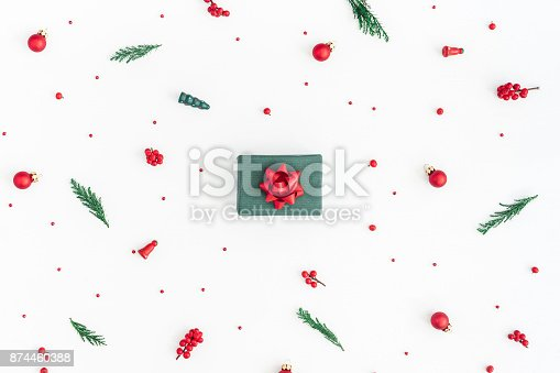 1060169304 istock photo Gift box, christmas tree branches, decorations. Flat lay, top view 874460388