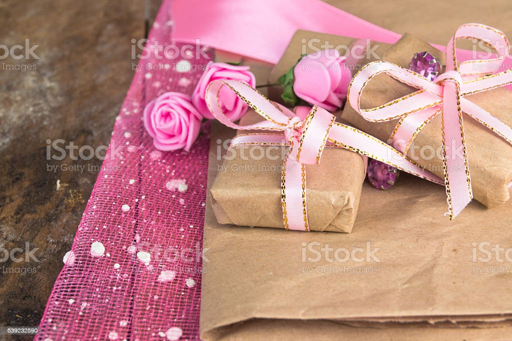 Gift box decor. Wrapped in parchment paper stock photo