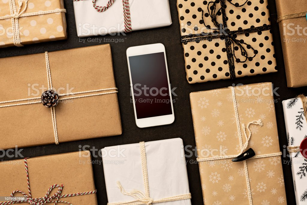 Gifts packaged with wrapping paper and tied with strings on black...