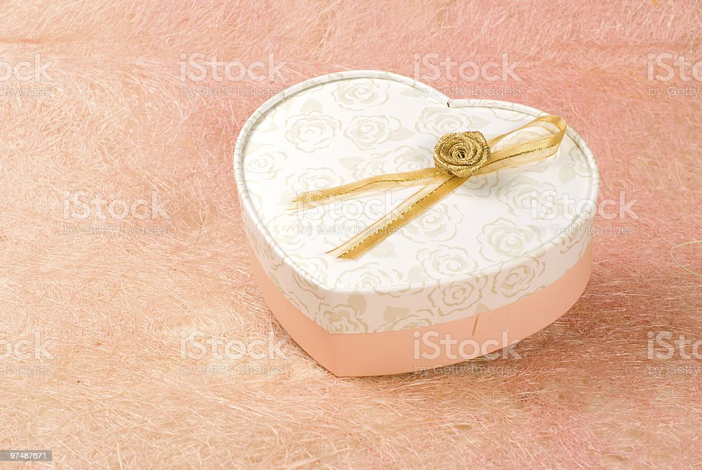 Gift box in heart pattern royalty-free stock photo