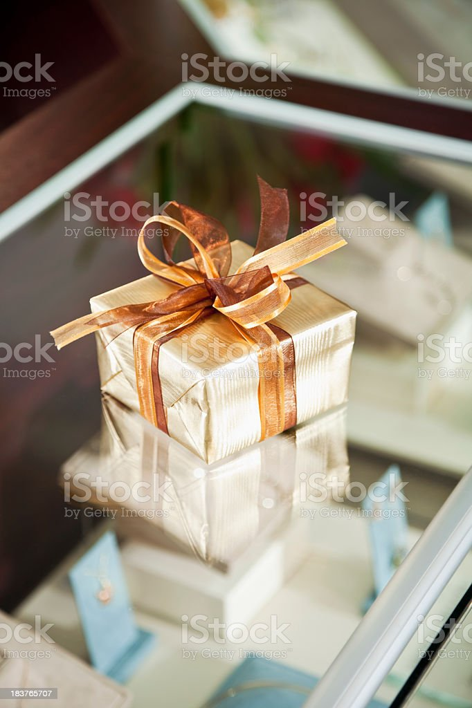 Gift box in jewelry store royalty-free stock photo