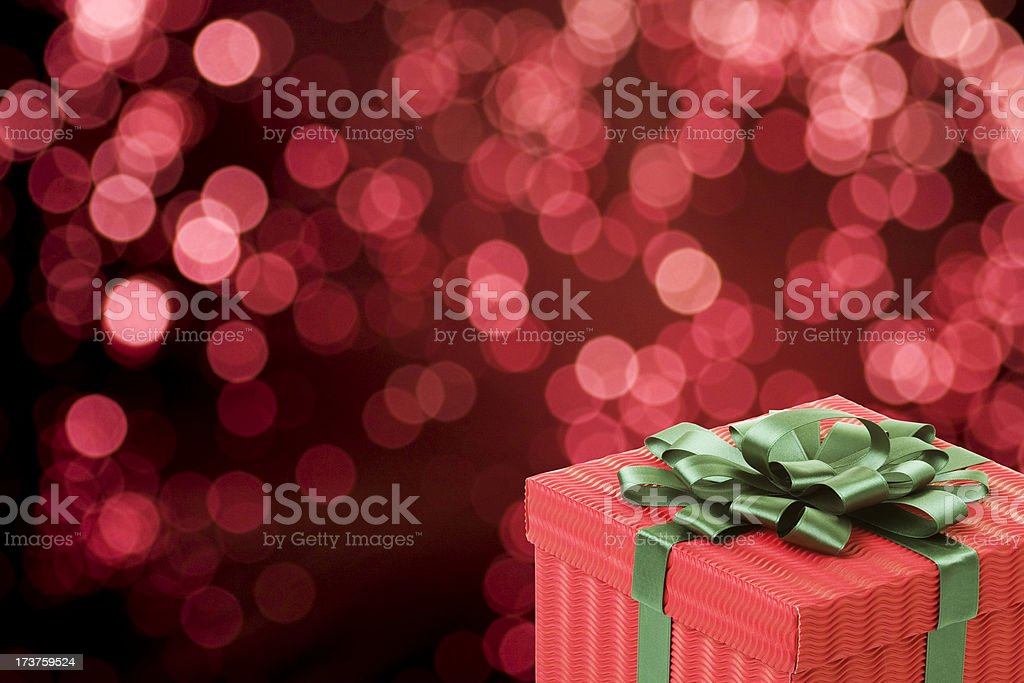 Gift Box in Red Lights Background royalty-free stock photo