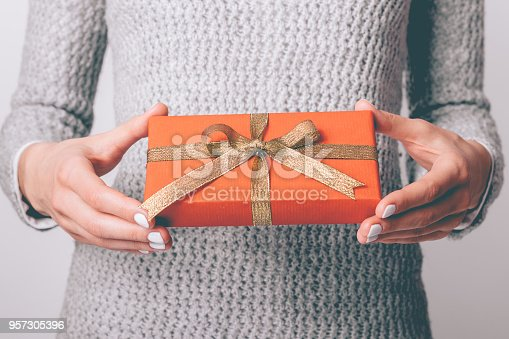 istock Gift box in red wrapping paper 957305396