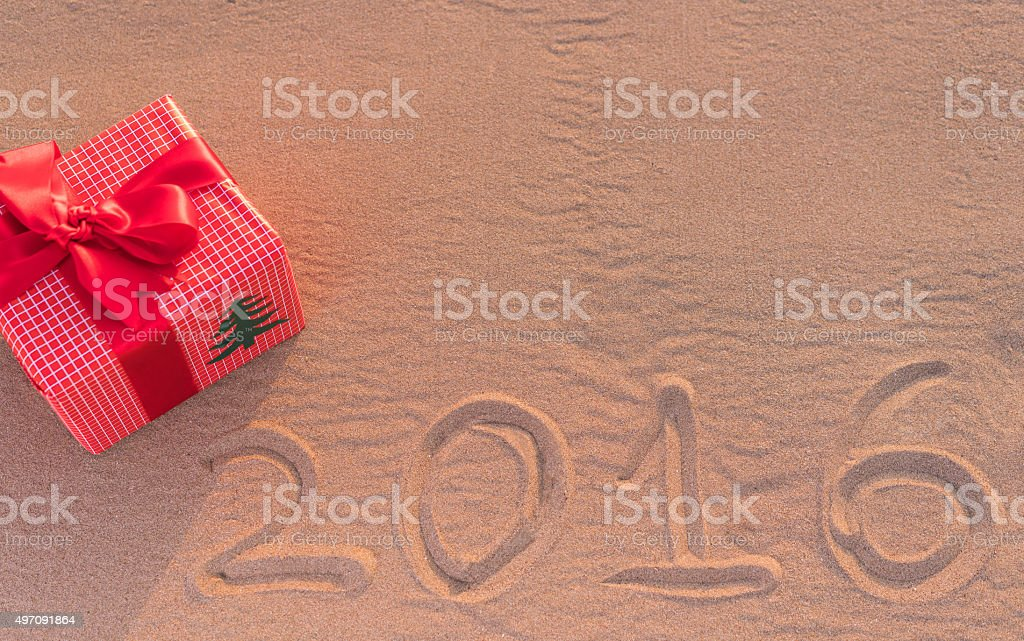 Gift Box In The Sand stock photo
