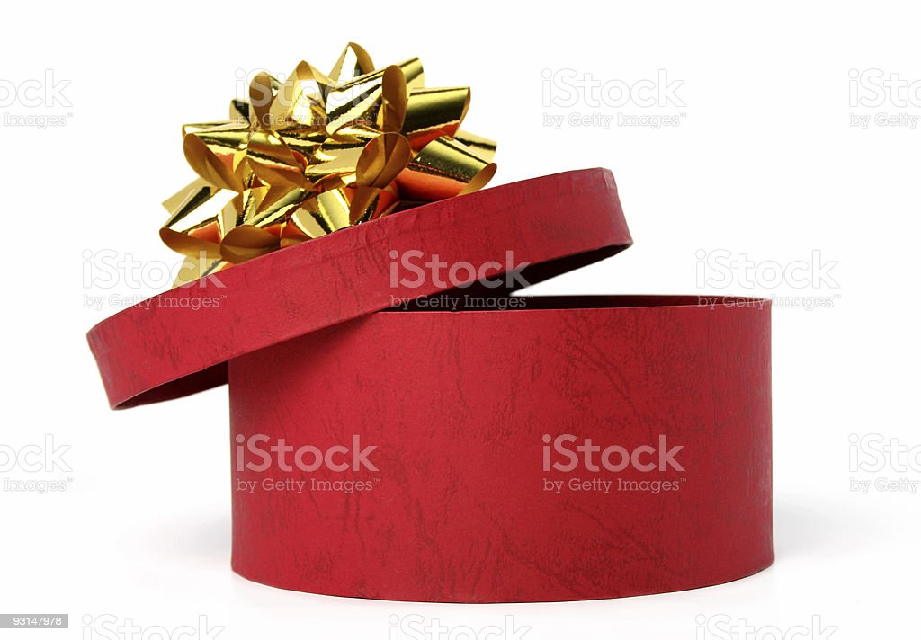 Gift box of red color with a golden bow royalty-free stock photo