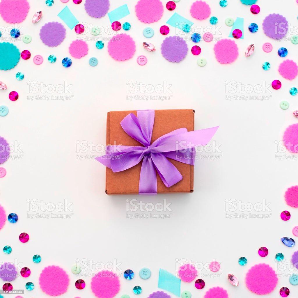 Gift box on festive pastel background. royalty-free stock photo