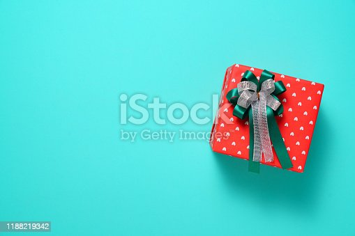 Gift box on green background view from above with copy space, New Year or Christmas festival concept